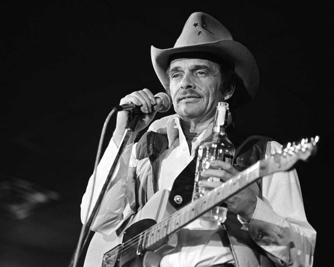 Man holding Microphone and guitar