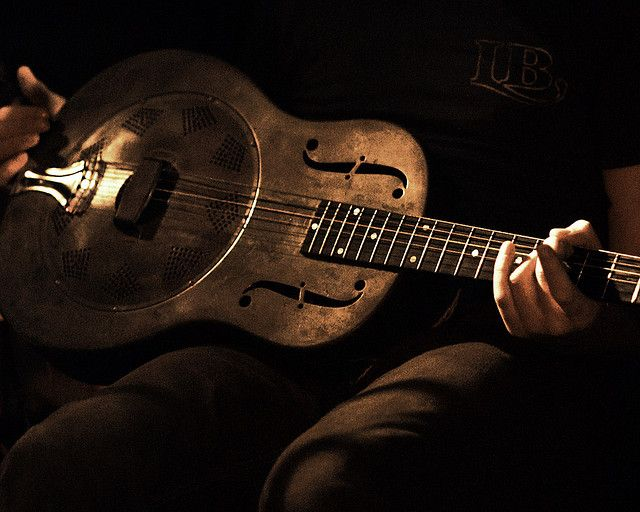 resonator guitar with a musician nowadays