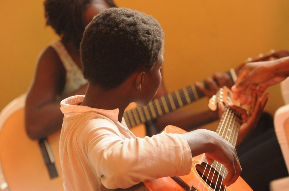 children eager to learn to play guitar