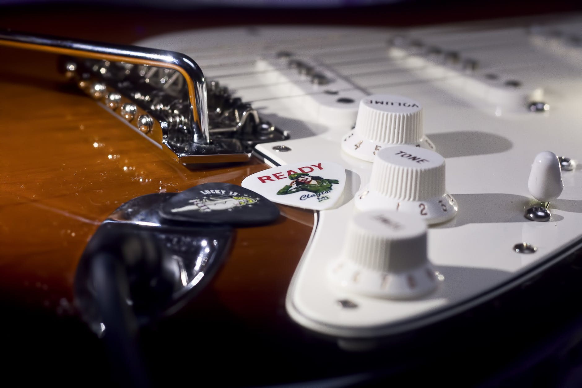 an electric guitar with an output jack