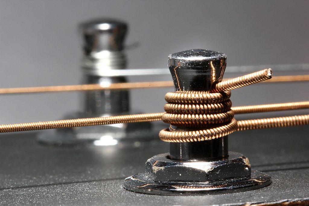 adjusting the set up of Guitar string pegs