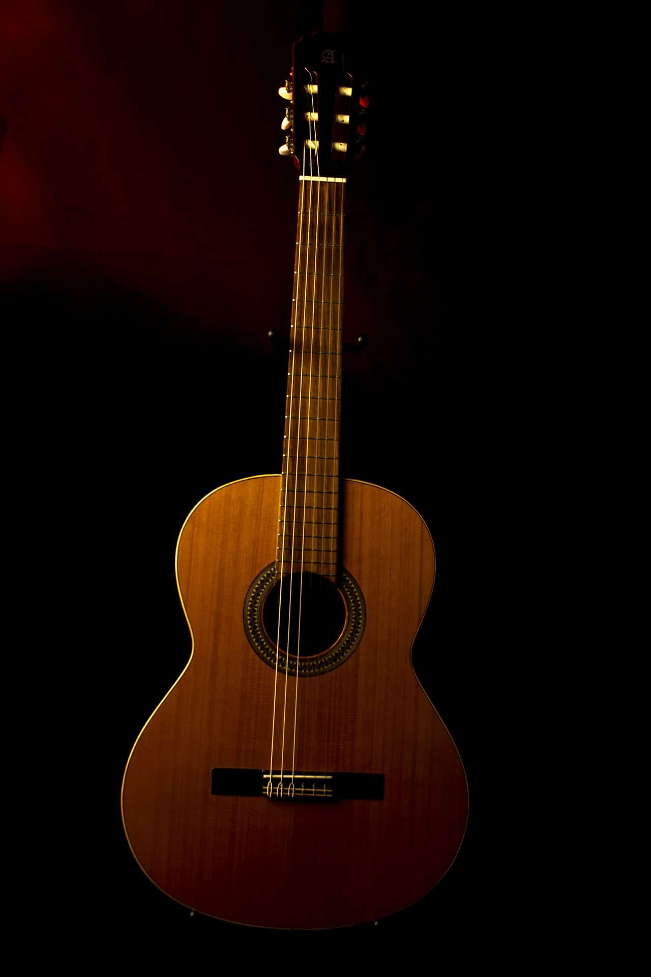 Modern acoustic guitar with a deeper and wider guitar body