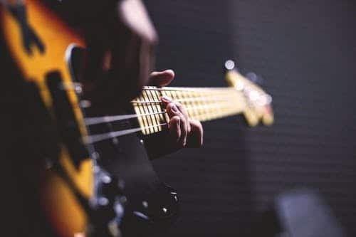 Hands playing guitar string